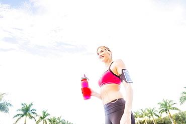 Woman drinking water from bottle, Jupiter, Florida