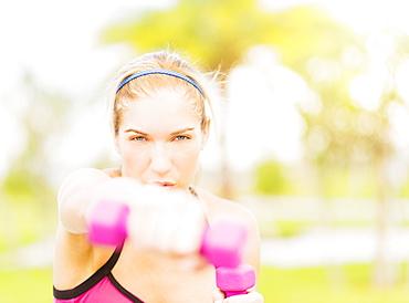 Young woman exercising in park, Jupiter, Florida
