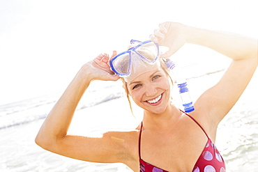 Portrait of smiling young woman wearing scuba mask and snorkel, Jupiter, Florida