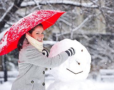 Woman making a snowman