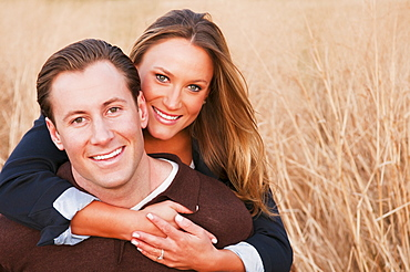 Portrait of happy young couple on wheat field