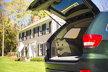 Open car trunk in front of house, Mendham, New Jersey
