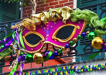 Mardi Gras mask hanging on balcony's railing, USA, Louisiana, New Orleans