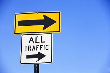 Arrow and All Traffic street signs