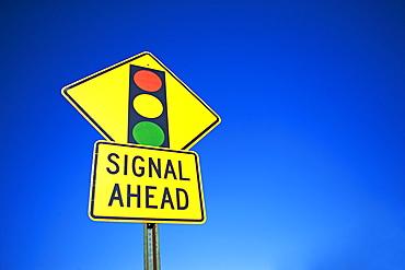 Traffic signal ahead street sign