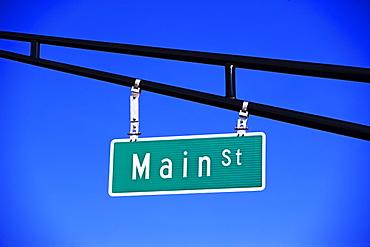 Main Street sign under blue sky