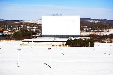 Blank billboard in snowy rural area