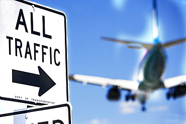 All traffic sign and airplane in background
