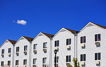 Row houses under blue sky