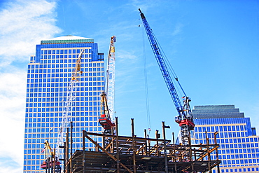 Urban construction site with cranes