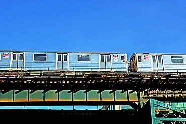 Elevated train under blue sky