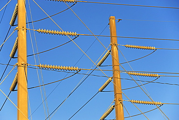 Low angle view of power lines on poles