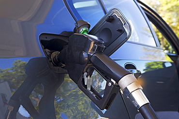 Close up of gas pump in car