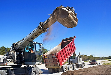 Dump truck and loader on construction site