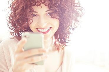 Beautiful brunette woman text messaging