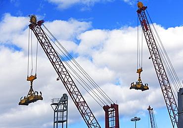 Cranes lifting cargo