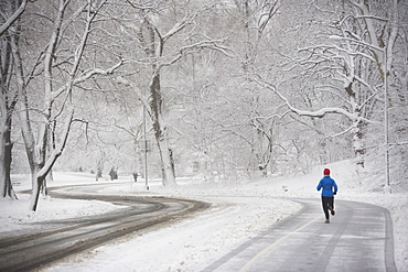 Jogger on snowy road