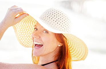 Portrait of woman wearing sun hat