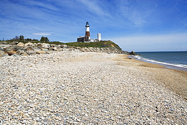 Beach with lighthouse in background