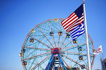 Flags in front of Ferris wheel