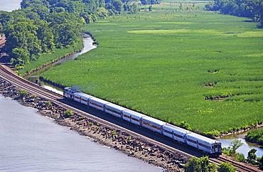 Train beside Hudson River