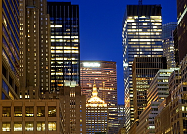 USA, New York State, New York City, Office buildings illuminated at night