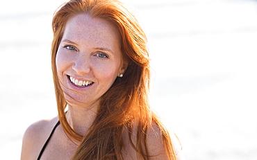 Portrait of woman on beach, Palm Beach, Florida