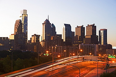 USA, Pennsylvania, Philadelphia, Comcast Center and traffic at dusk