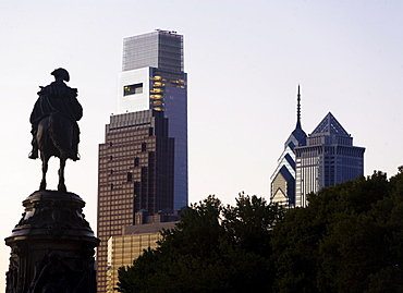 USA, Pennsylvania, Philadelphia, Silhouette of statue, Skyscrapers in background