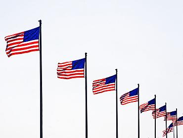 USA, Pennsylvania, Philadelphia, American flags against sky