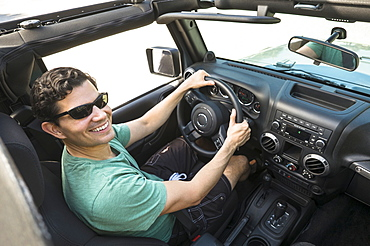 Elevated view of man driving car