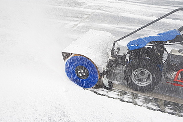 USA, New York City, machine removing snow