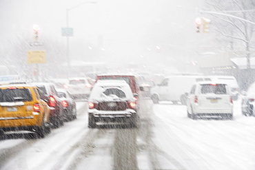 USA, New York City, city traffic in snowstorm