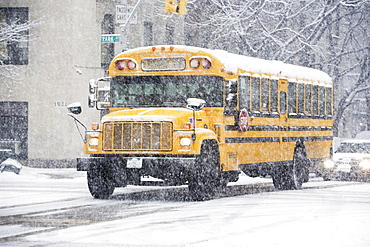USA, New York City, school bus in blizzard