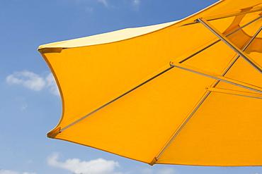 USA, Florida, Miami, Yellow sunshade against blue sky