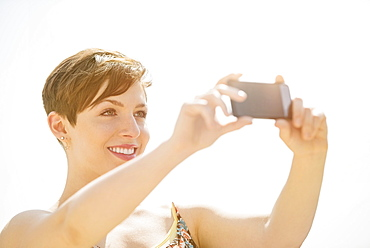Young woman taking selfie with mobile phone