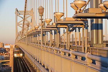 USA, Pennsylvania, Philadelphia, close-up view at Benjamin Franklin Bridge at sunset