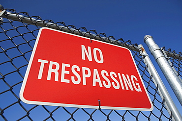 Low angle view of no trespassing sign