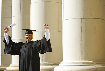 Male graduate cheering
