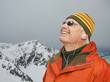 Man wearing earbuds in mountains