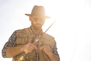Portrait of man holding fishing rod