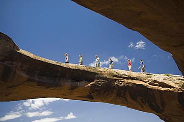 People walking on rock formation