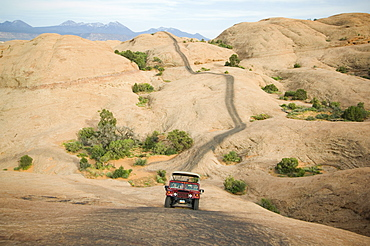Off-road vehicle driving on rock formation