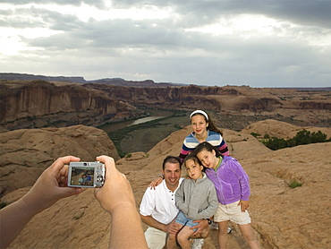 Father and daughters having photograph taken