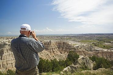 Man taking photograph of canyons