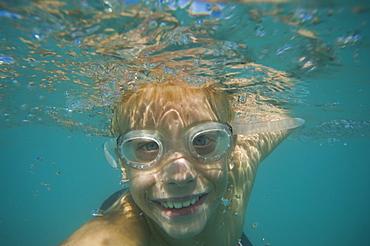 Underwater shot of boy swimming, Utah, United States