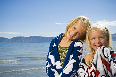 Sisters wrapped in beach towels, Utah, United States