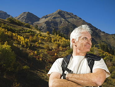 Senior man wearing backpack, Utah, United States