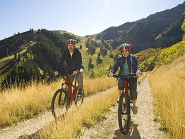 Senior couple riding mountain bikes, Utah, United States