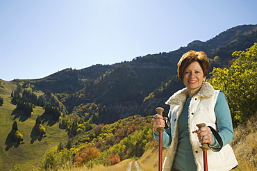 Senior woman holding hiking poles, Utah, United States